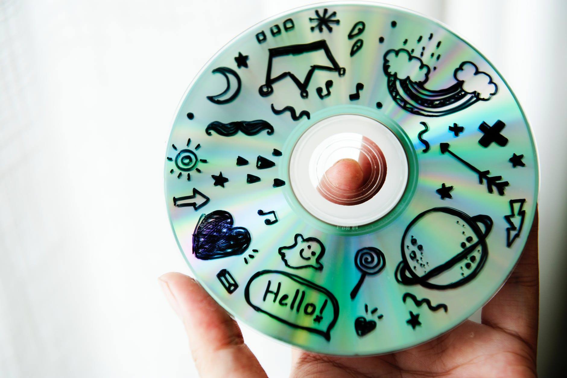 person holding cd