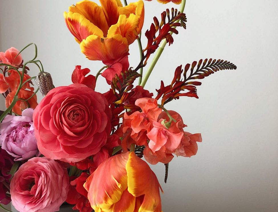 colorful spring bouquet in modern vase
